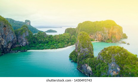 Aerial view of Phranag Beach, Railay Bay in Krabi Thailand with the spectacular mountain and white beach along the emerald water and island in morning.