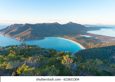 Aerial view of picturesque beach and mountains on sunny morning. Freycinet Park, Tasmania. Australia