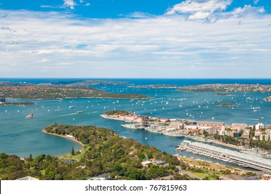 Aerial view of picturesque Sydney Harbour with view of Royal Botanic Gardens, Woolloomooloo and Vaucluse suburbs on sunny day. Sydney, Australia