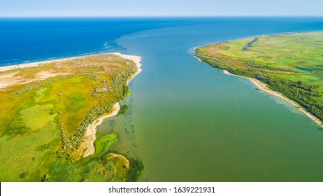 Aerial view of the place where Danube River merges with Black Sea in Romania