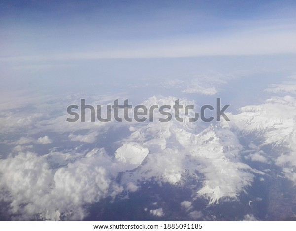 Aerial view from the plane over the clouds