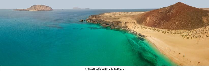 Aerial view of the Playa de las Conchas and mountain Bermeja, La Graciosa island in Lanzarote, Canary island. Spain. Ocean view and sand beach
