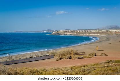Aerial view of Playa de Tejita sand beach and Tenerife island south coast. Canary islands, Spain.