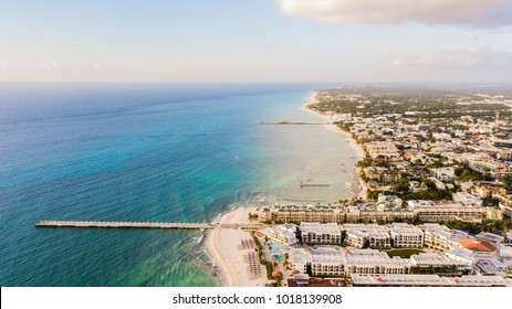 Aerial view of Playa Del Carmen, Mexico showing luxury resorts and blue turquoise beach during sunrise