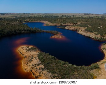 Aerial view from a pond with contaminated waters of an old mine