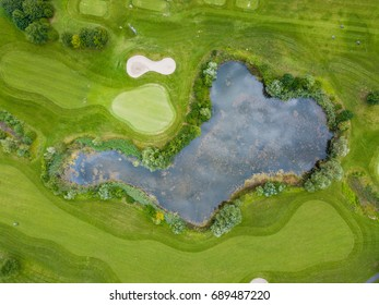 Aerial view of pond on golf course in Europe