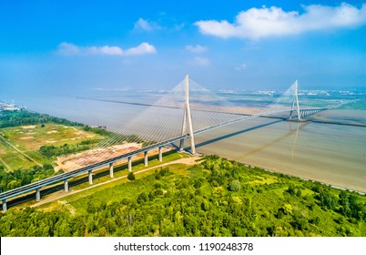 Aerial view of the Pont de Normandie, a cable-stayed road bridge that spans the river Seine linking Le Havre to Honfleur in Normandy, northern France
