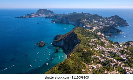 Aerial view of Ponza, island of the Italian Pontine Islands archipelago in the Tyrrhenian Sea, Italy. On the island there are few houses between the Mediterranean vegetation and the sea.