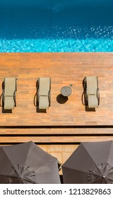 Aerial view of pool with sun umbrellas on deck