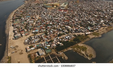 Aerial view poor district of Manila's slums, ghettos, wooden old houses, shacks. Slum area of Manila, Philippines. Manila suburb, view from the plane.