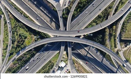 Aerial view of popular highway of Attiki Odos multilevel junction road, passing through National motorway in traffic jam, Attica, Greece