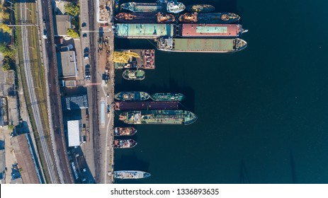 Aerial view of the Port Harbor in Odessa with moored ships of different purposes, Ukraine. Top view. Drone shot