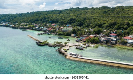 Aerial view of port with many wrecked ships in Wakatobi, Indonesia, Asia