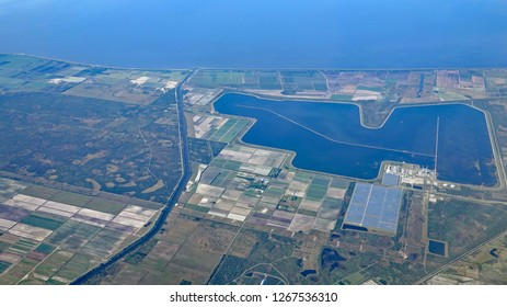 Aerial view of Port Mayaca, Lake Okeechobee, and the Martin County power plant, with cooling lagoon and solar panels.