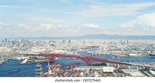 Aerial view of port of Osaka - Harbour city concept image, panoramic modern cityscape building bird's eye view, shot in Sakishima Cosmo tower observatory, Osaka, Japan.