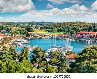 Aerial view of the port of Vrsar (Orsera) town. Colorful spring cityscape of Croatia, Europe. Traveling concept background. Magnificent Mediterranean seascape.