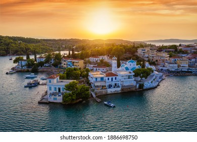 Aerial view of Porto Cheli, a luxury seaside retreat at the east edge of the Peloponnese peninsula, Greece, during a clorful summer sunset