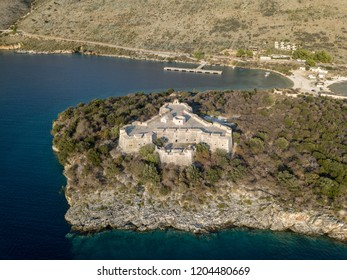 Aerial view of Porto Palermo Castle with mountain and sea at sunset (Himara, Albania)