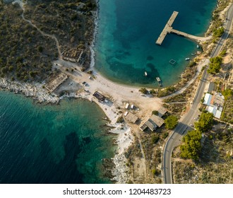 Aerial view of Porto Palermo Castle, island and army ruins located in Himara, Albania