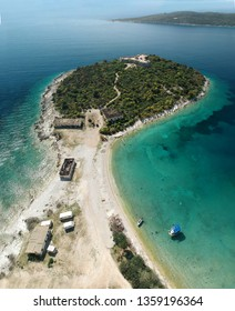 Aerial view of Porto Palermo Castle on island with beautiful Mediterranean waters in Himara, Albania
