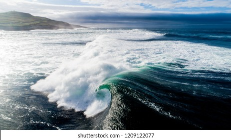 Aerial view of powerful breaking ocean waves of the Atlantic.  Blue skies and nice weather as the great big wave spot mullaghmore breaks.  Perfect waves for surfing.