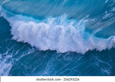 Aerial view of powerful wave breaking near shore