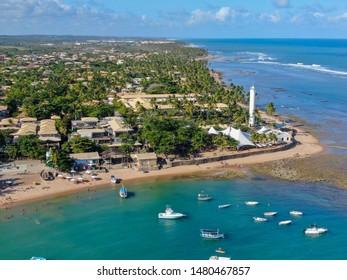 Aerial view of Praia Do Forte coastline village with beach and blue clear sea water, Bahia, Brazil. Travel tropical destination.