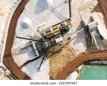 Aerial view of the processing plant with the sand fractionator at the edge of a quartz sand quarry pond for white quartz sand, made with drone