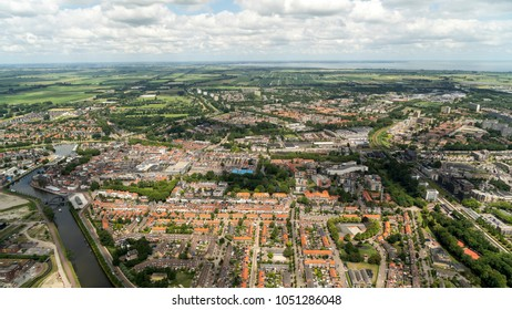 Aerial view of Purmerend, a city in the province Noord-Holland in The Netherlands. Beautiful town with a crystal clear horizon with cumulus clouds.