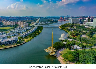 Aerial View Of Putrajaya Lake With Monument Tower And Putrajaya Bridge View