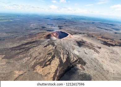 aerial view of Puu Ooo Volcanic cone on the Big Island of Hawaii. Volcanic gas can be seen escaping from the crater.