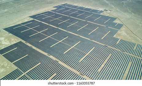 An aerial view of a PV Plant over the Atacama desert in Chile, trying to get the energy from the sun with Solar Energy