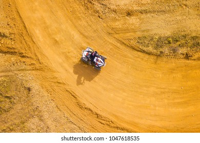 Aerial view of quad bike in racetrack. Outdoor motor sport from drone view.