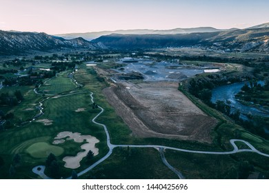 Aerial View of a Quarry in Colorado next to a fairway in a Golf Course.