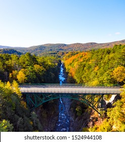 Aerial view of Quechee Gorge bridge in Vermont during fall season