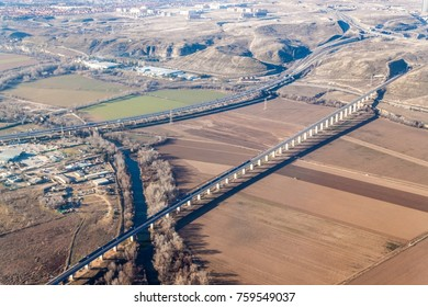 Aerial view of R3 motorway and a high speed rail near Madrid, Spain