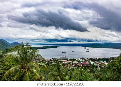 Aerial view to Rabaul near Tavurvur volcano. Tropical landscape , a lot of clouds. New Britain Island, Papua New Guinea
