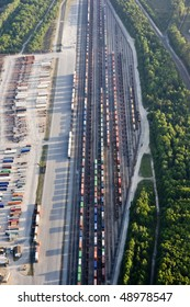 aerial view of railroad yard with trucks