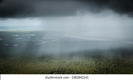 Aerial view of rain showers near Glyde Point, Northern Territory