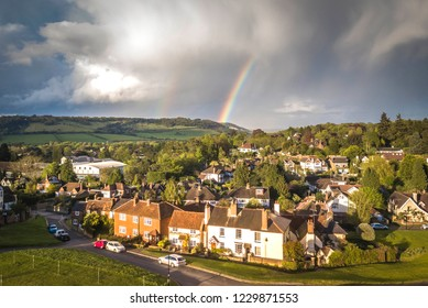 Aerial view of a rainbow over Dorking and the Surrey Hills, a typical souther English Village south England