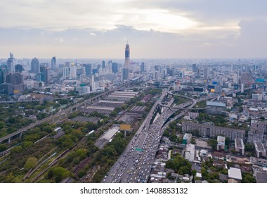 Aerial view of Rama 9 road, New CBD, Bangkok Downtown, Thailand. Financial district and business centers in smart urban city in Asia. Skyscraper and high-rise buildings. Top view.