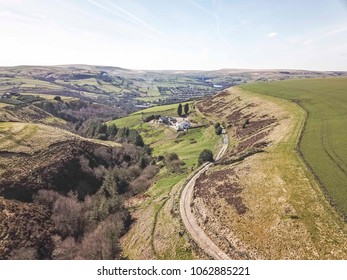 Aerial view of a ravine leading towards Rishworth from Ringstone Edge Reservoir, West Yorkshire, UK