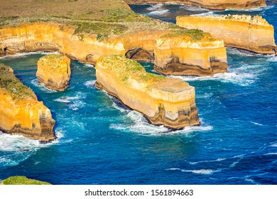 An aerial view of the Razorback and Tom and Eva (Island Archway), are rock stacks within Port Campbell National Park, Victoria, Australia.