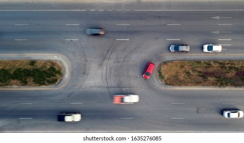 Aerial view of red car making a U-turn.  - Shutterstock ID 1635276085