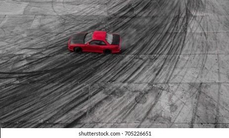 Aerial view Red race car drifting on race track.