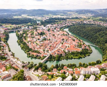 Aerial view of red roofs of Novo Mesto (previously Rudolfswerth, Newestat), Slovenia, Lower Carniola region, near Croatia. Historic Kandija iron bridge (Old Bridge), on the bend of the Krka River. - Shutterstock ID 1425800069