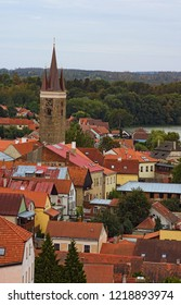 Aerial view of red tile roofs in Telc. Clock tower in historic centre of Telc. A UNESCO World Heritage Site. Southern Moravia, Czech Republic