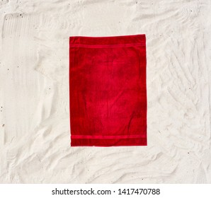 Aerial view of red towel on sand and beach . Free space for your decoration. Summer time