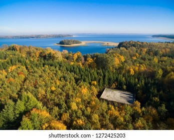 Aerial view of reinforced concrete bunkers belonged to Headquarters of German Land Forces from ww2 hidden in a forest in autumn season in Mamerki, Poland (former Mauerwald, East Prussia)