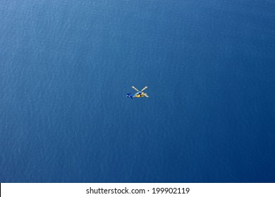 Aerial view of Rescue Helicopter in Vast Ocean.